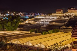 Night scene of a valley in Dalat with the greenhouses to plant flowers and vegetables