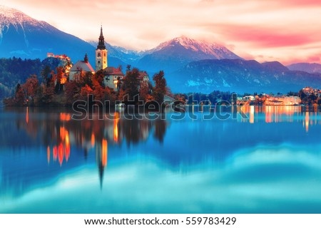 Night scene of Bled lake in Slovenia, famous and popular travel destination for romantic couple in love. Artistic toning landscape. Fantasy post processing.