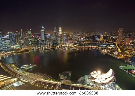 Night scene of financial district, Singapore From the river