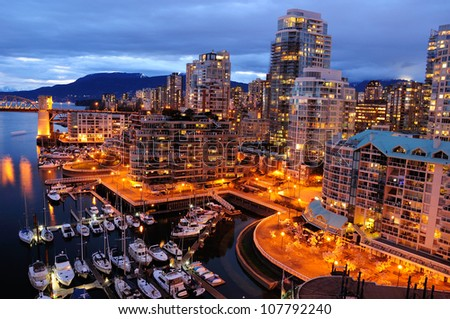 Night scene of modern buildings in vancouver downtown, british columbia, canada