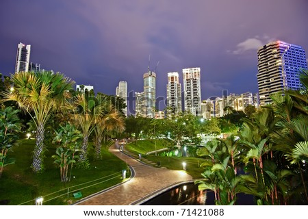 Night scene of modern city with park in Kuala Lumpur, Malaysia, Asia.