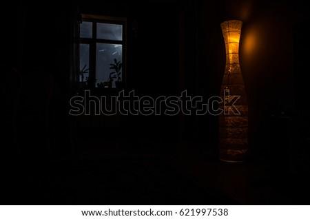 Night scene of moon seen through the window from dark room. Moonlight inside dark room #621997538