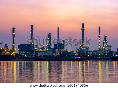 Night scene of oil refinery plant of Petrochemistry industry in twilight time and reflection in near river in Bangkok, Thailand.  stock photo