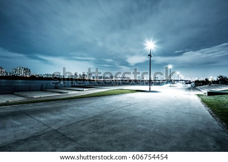 night scene of seoul from empty road near river