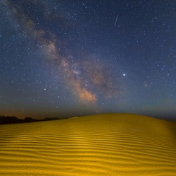night scene, sandy desert after a rain under the starry sky with milky way
