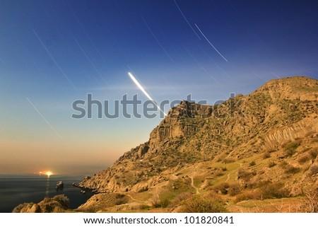 night scene, sea bay, dark sky and stars tracks