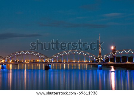 Night scene with city river and sky in  Riga