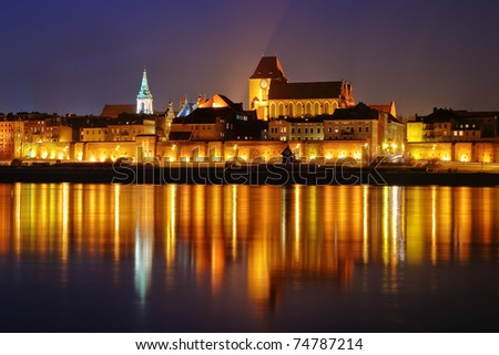 Night scene with medieval city Torun, Poland