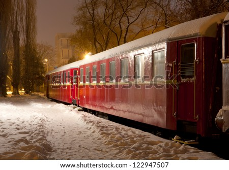Night scene with old train cars in winter