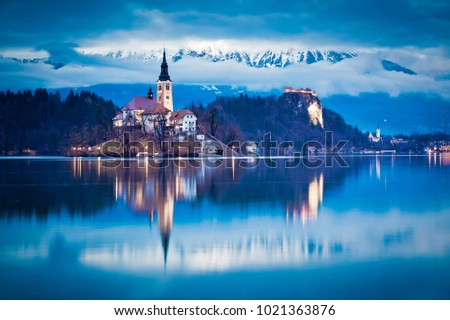 Stock Photo night scenery at Bled lake with church on island . Dramatic , picturesque fall scene. Popular tourist attraction. Bled town, Slovenia, Europe.
