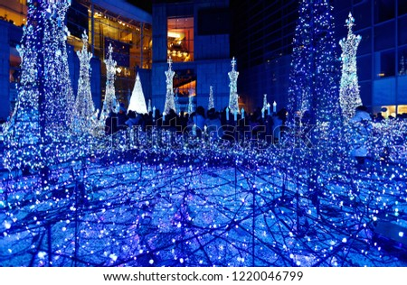 Night scenery of Winter Illumination Display in a pedestrian square in Caretta Shiodome Shopping Area, Tokyo, Japan, with decorated Christmas trees and dazzling lights in a romantic dreamy atmosphere #1220046799