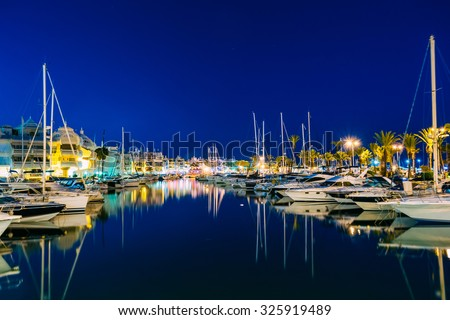 Night Scenery View Of Embankment, vessel In Benalmadena. Benalmadena is a town in Andalusia in Spain, 12 km west of Malaga, on the Costa del Sol. It caters for a large number of tourists. #325919489