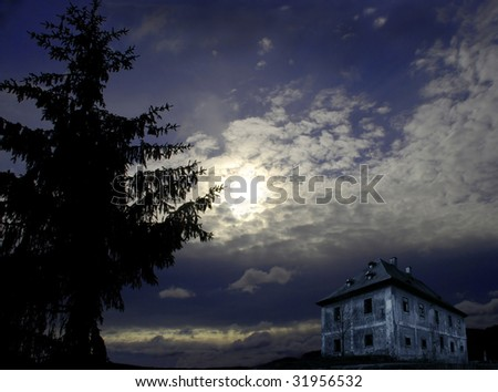 Night scenery with big tree, mysterious house and full moon