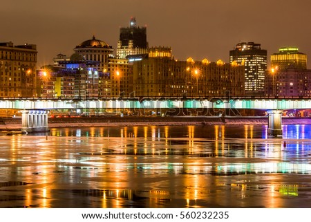 Night scenic view on city and the bridge over Moscow river. On the background the building of Ministry of Foreign Affairs under reconstruction. Russia. #560232235