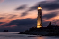 Night shifts (Lighthouse at Cape Tarkhnkut, Crimea after dark)