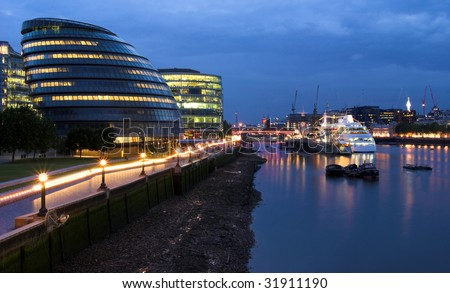 Night shot from Tower bridge over the Thames towards London City Hall