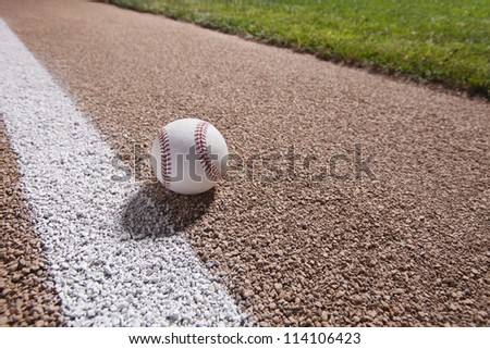 Night shot of baseball on a base path with grass infield