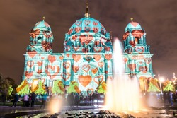 night shot of illuminated Berlin Cathedral with fountain