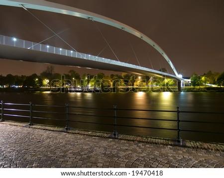 Night shot of lights arch Tongeren bridge in Maastricht, Netherlands.