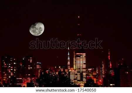 Night shot of Moon in city skyline with red filter.