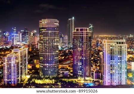 Night shot of skyline of Makati, Philippines - stock photo