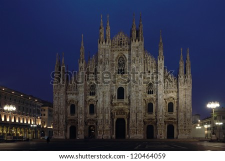 Night shot of the famous Milan Cathedral over clear dark blue sky. - stock photo