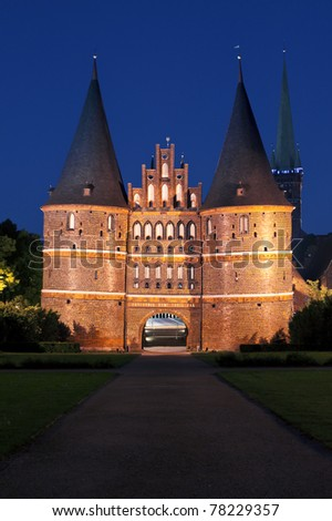 Night shot of the Holstentor building at Lübeck