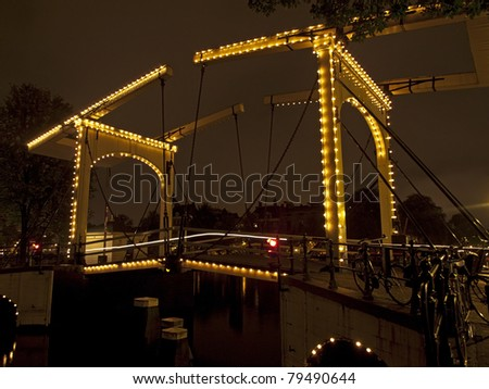 night shot of the Magere Brug (skinny bridge) in Amsterdam, Netherlands - stock photo