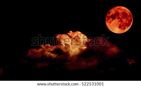 Night sky and a full moon in the clouds, blood moon concept