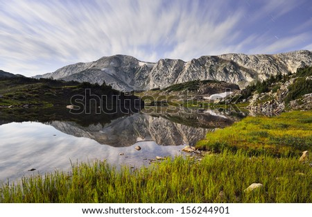 night sky and reflection in Medicine Bow Mountains in Wyoming during summer #156244901