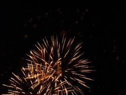 night sky firework explosion bright yellow red lights
