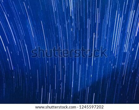 Night sky star trail, Star trail, Rotating star, Night sky star trail for background.Abstract background.grain #1245597202