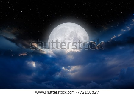 Night sky with full moon in the clouds 'Elements of this image furnished by NASA Сток-фото ©