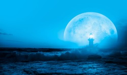 Night sky with full moon in the clouds, on the foreground lighthouse