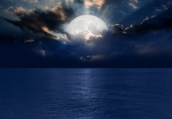 Night sky with moon in the clouds