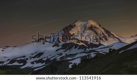 Night sky with mountain - stock photo