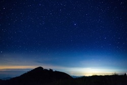 night sky with star on top of mountain