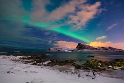 night sky with stars and northern lights over the Lofoten archipelago in Norway