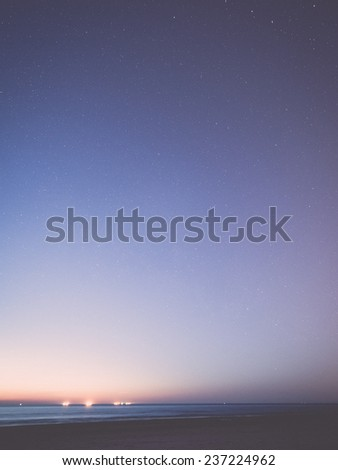 night sky with stars on the summer beach. space view from earth - retro, vintage style look