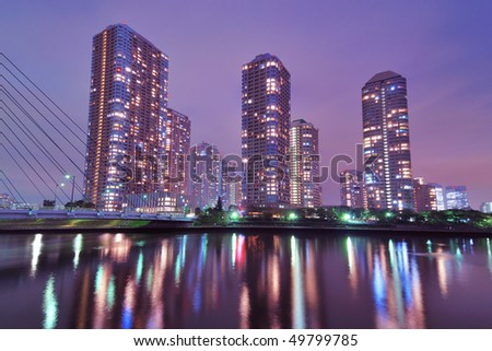 night skyscrapers cityscape in Tokyo metropolis over Sumida river waters