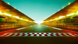 Night speedy motion blur international race track with starting and finishing line .