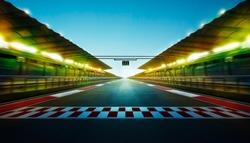 Night speedy motion blur international race track with starting finishing line and light .