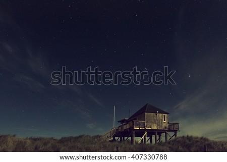 Night stars at Muriwai Beach #407330788