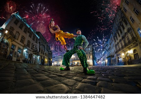 Night street circus performance whit clown, juggler. Festival city background. fireworks and Celebration atmosphere. Wide engle photo #1384647482