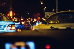 night street filled with cars creating a traffic jam