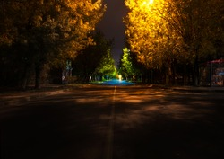 night street in autumn, in europe, small town, night lamps