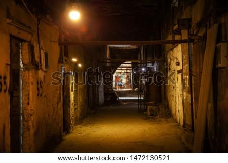 Night street. Narrow street. Dark street illuminated with street lamps. Stone pavement in the old town. Evening urban landscape #1472130521