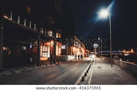 stock photo night street near the art space red october 416375965 - Каталог — Фотообои «Улицы, переулки»
