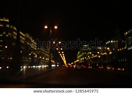 Night street traffic on Heydar Aliyev avenue.