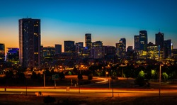 Night time cityscape nightscape of the capital cities , Denver Colorado skyline cityscape perfect time lapse of the downtown urban skyscrapers and office buildings at sunrise